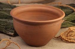 Large handmade clay pot for baking kilned with milk
