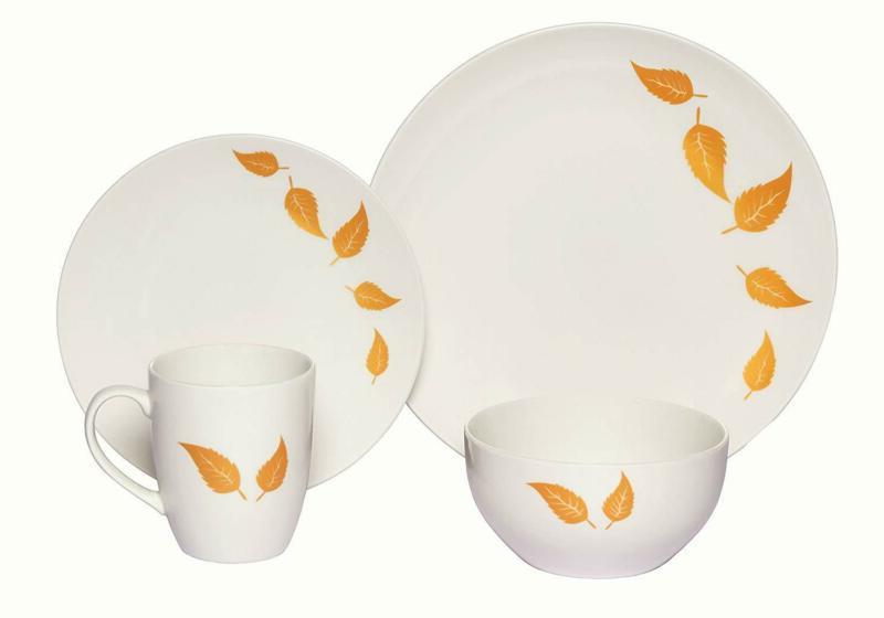 coupe 16 piece porcelain dinnerware set gold